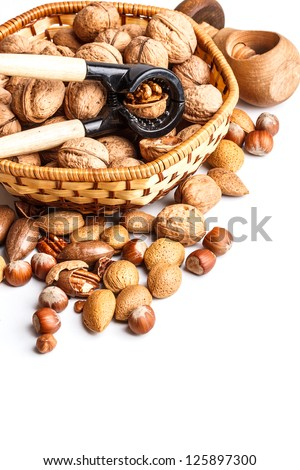 Different kinds of nuts with nutcracker