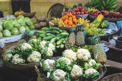 Different kinds of vegetables for sale at a market. Fruits and vegetables at the vegetable street market in India