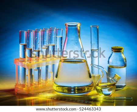Different laboratory beakers and glassware. Multicolored.
