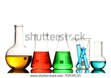 Different laboratory glassware with color liquid and with reflection isolated on white - stock photo