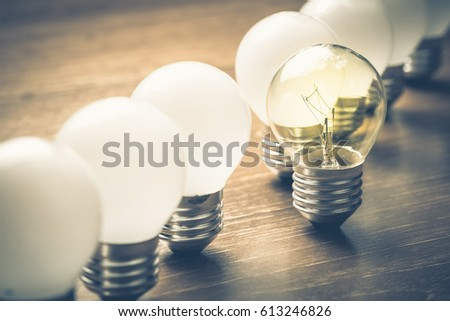 Different light bulb standing out of the row #613246826
