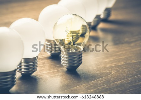 Different light bulb standing out of the row #613246868