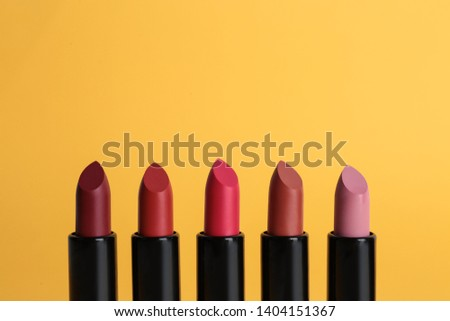Different lipsticks on color background. Makeup cosmetic product #1404151367