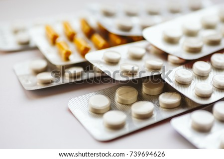 Different medicines: tablets, pills in blister pack, medications drugs, macro, selective focus, copy space