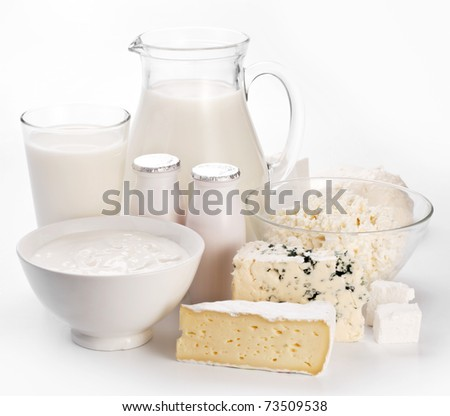 Different milk products. On a blue background.