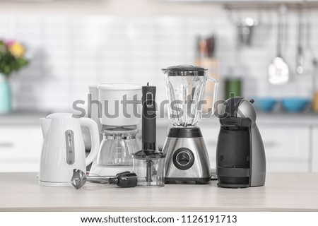Different modern kitchen appliances on table indoors. Interior element