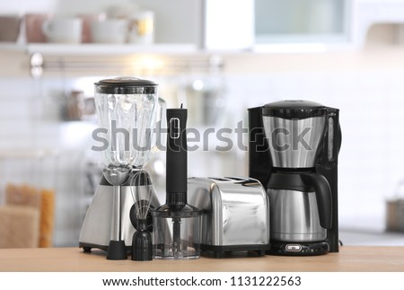Different modern kitchen appliances on table indoors. Interior element #1131222563