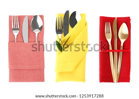 Different napkins with cutlery on white background, top view. Table setting