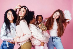 different nation girls with diversuty in skin, hair. Asian, scandinavian, african american cheerful emotional posing on pink background, woman day celebration, lifestyle people concept
