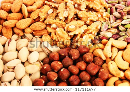 Different nuts as a background.