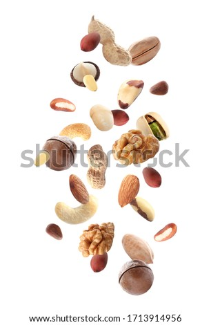 Different nuts falling on white background  Stockfoto ©