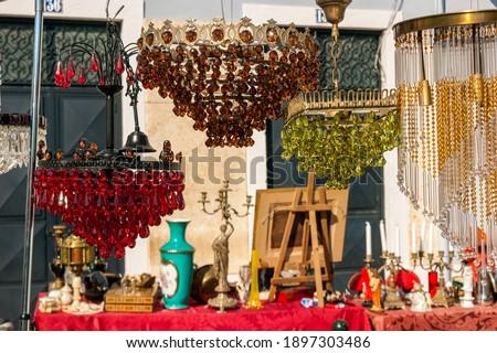Different objects for sale in the antique flea market called Feira da Ladra in Alfama at Campo de Santa Clara, Lisbon