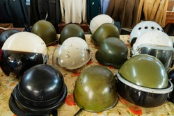 Different Old Military khaki helmets. helicopter pilot, Flight,Retro style motorcycle helms.  Concept soldiers and military