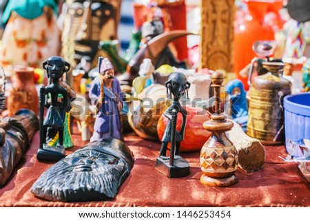 Different old statuettes, figurines and handicraft at european flea market. Alsace, France