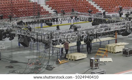 Different parts of metal scaffold on construction field. Workers build a concert stage. worker build a concert stage. stage equipment
