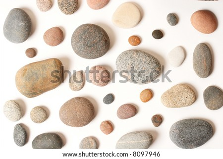 Different pebbles on white (with a shadows)