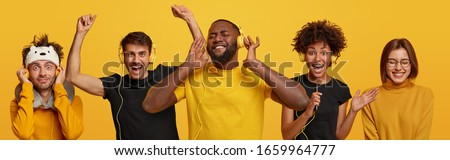 Different people enjoy listening music in headphones, dance carefree and sing favourite songs, have upbeat mood, wear yellow and black clothes, feel energized and upbeat. Relax and hobby concept Photo stock ©