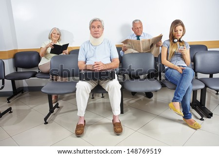 Different people sitting in a waiting room of a hospital #148769519