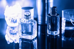 Different perfume bottles and candle. Perfumery, cosmetics branding and luxe concept. Classic Blue