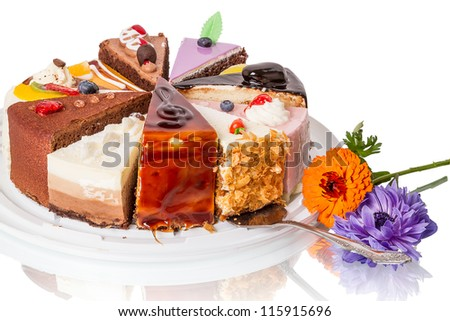 Different pieces of cake and flower. Isolated on white background.