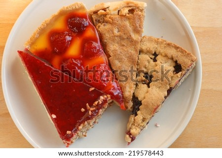 Different pieces of cake and pie on a plate, warm autumn colors, top view