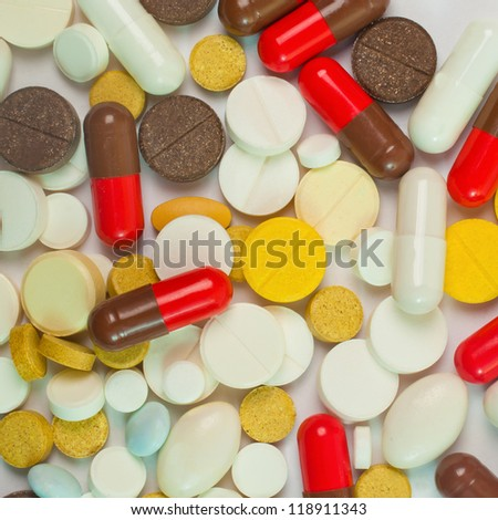 Different pills lying in the background