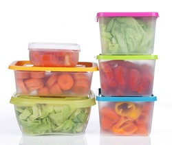 Different plastic boxes for storage with vegetables