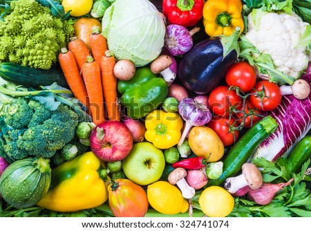 Different raw vegetables and fruits background.Healthy eating.