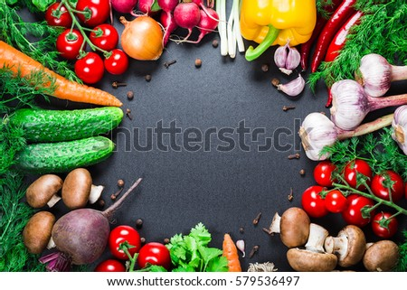 Different raw vegetables and spices on black background. Healthy eating. Autumn harvest and healthy organic food concept #579536497