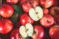 different red and brilliant apples background .