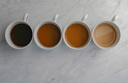 Different shades of coffee with milk. From black coffee to milky coffee.