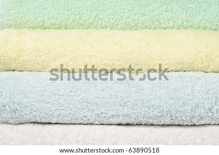 Different shades of  towels stacked on each other