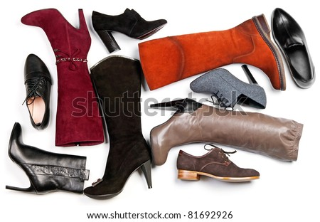 Different shoes and boots over white background