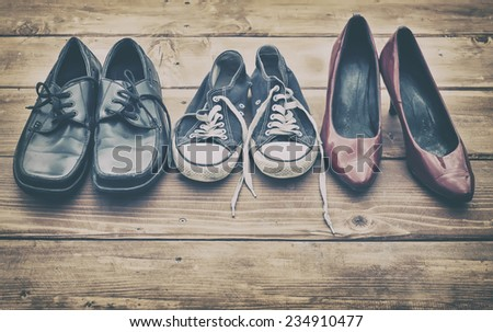 Different shoes on a wooden table #234910477
