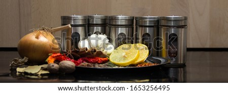 different silver spice shakers, silver plate with spices (close-up shot) in panoramic format