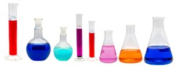 Different sizes and shapes of some glassware laboratory equipment such as erlenmeyer, graduated cylinder, reaction flask containing multi-colored solutions isolated on white background.