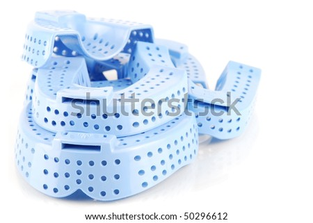 different sizes of acrylic trays for teeth impressions