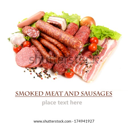 different smoked meat and sausage on a white background