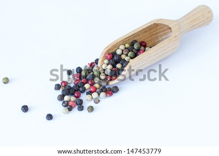 Different sorts of pepper on white background
