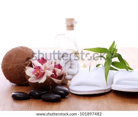 Different spa items over wooden surface