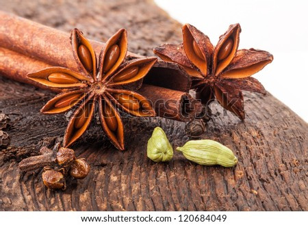 Different spices, Cinnamon, anise on wooden old table, on white background