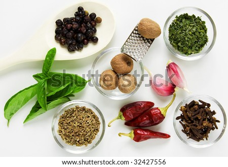 Different spices on the table on white