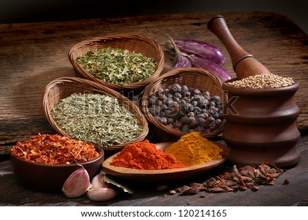 Different spices over a wood background. Various colors and textures