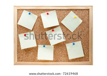 different sticky notes on a cork board isolated on a white background