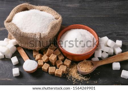 Different sugar on dark table Foto stock ©
