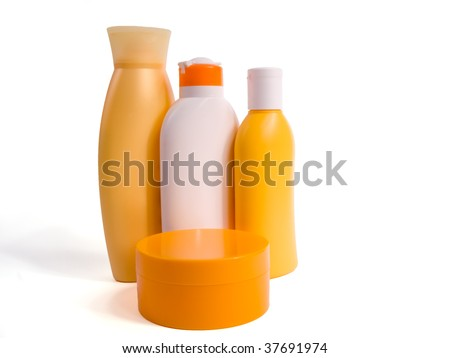 Different suncreams and lotions on a white background