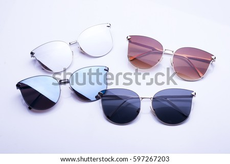 Different sunglasses on white background #597267203