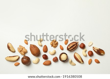 Different tasty nuts on white background, space for text Сток-фото ©