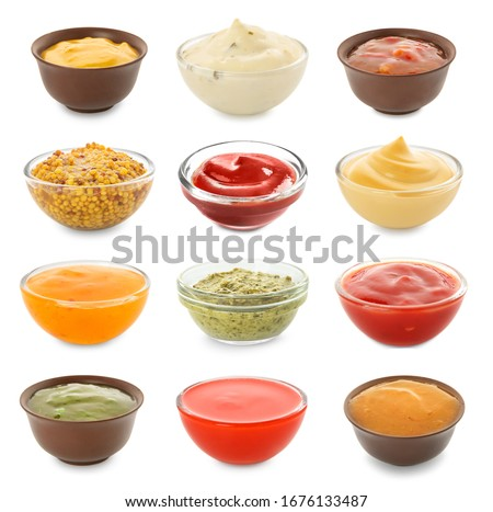 Different tasty sauces in bowls on white background Сток-фото ©