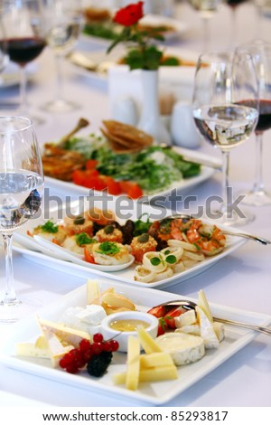 Different tasty snacks for wine on luxury banquet table